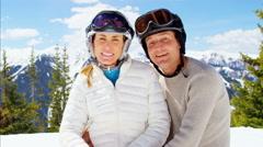 Portrait male female Caucasian couple winter skiing snow sport travel activity Stock Footage