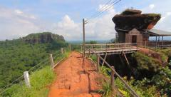 Phu Thok, travel in Thailand. Wooden ladder on the side of the rocky mountains. Stock Footage