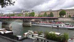 The Pont des Arts bridge (in 4k) over the River Seine, Paris, France. - stock footage