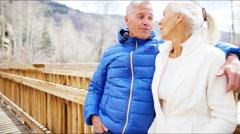 Stock Video Footage of male female Caucasian couple seniors Rockies mountains winter tourism resort