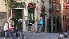 Tourists walking in characteristic small streets in Genoa, Italy Stock Footage