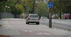 Parked CarsCars go by Paved Road Street Street Traffic Sign On The Post On The Stock Footage