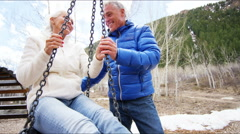Stock Video Footage of Aspen American mature happy swing outdoor health pensions