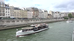 Tourist boats (in 4k) on the River Seine, Ile de la Cité, Paris,  France. Stock Footage