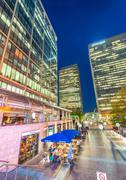 LONDON - JUNE 15, 2015: Canary Wharf at night. Canary Wharf with its tall bui - stock photo