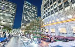 LONDON - JUNE 15, 2015: Canary Wharf at night. Canary Wharf with its tall bui Stock Photos