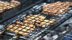 Pork chops getting grilled on grill with flames. Stock Footage