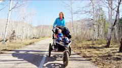 Stock Video Footage of outdoor recreation Caucasian Aspen mum baby family hiking spring walk stroller
