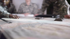 4K Female military officers in army office, looking at a map  Stock Footage