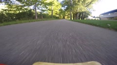 Longboarder going down road fast Stock Footage