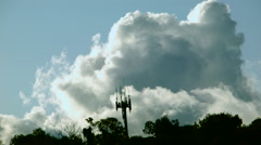 Cloud time-lapse past cell phone tower Stock Footage