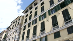 Buildings facing the port area in Genoa, Italy Stock Footage