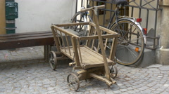 Old wooden cart in the city center of Sibiu Stock Footage