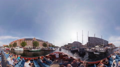A tourist sightseeing boat sails the Christianshavns Kanal with yachts boats Stock Footage
