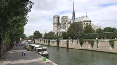 The Notre Dame Cathedral (in 4k) and the River Seine, Paris, France. Stock Footage