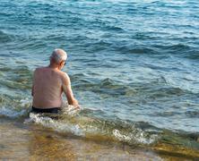 Old man enjoying summer time - stock photo