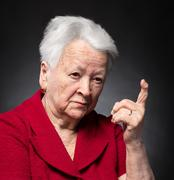 Portrait of old woman in angry gesture - stock photo