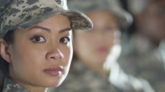 4K Close up on faces of mixed ethnicity female soldiers  - stock footage