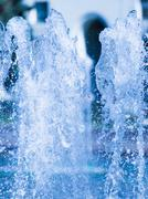 vertical abstraction of water splashing - stock photo