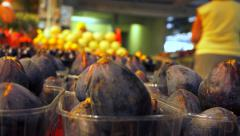 Fresh fruit shop - stall of fig in a market - panoramic shot Stock Footage
