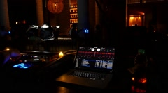 Dj Disc Jockey at Turntable in Nightclub with Illuminated Go-Go Girl Dancers Stock Footage