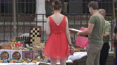 Buying souvenirs from a street market, Sibiu Stock Footage