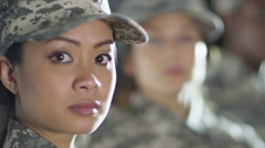 4K Close up on faces of mixed ethnicity female soldiers  Stock Footage