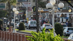 Traffic in a Mediterranean coastal city of Spain at sunset Stock Footage