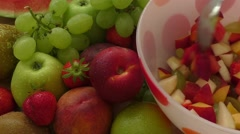 Fresh tasty fruit salad in the bowl Stock Footage