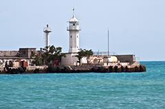 Old lighthouse in the Crimea Stock Photos