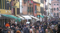 Tourists and citizens in busy Venetian street Stock Footage