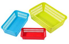 Several small different colored plastic baskets for household use Stock Photos