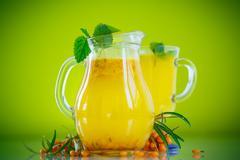 juice from ripe sea-buckthorn berries - stock photo