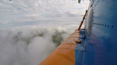 The helicopter is flying above the clouds Stock Footage