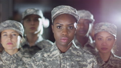 4K Mixed ethnicity female soldiers stand to attention and salute Stock Footage