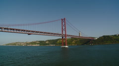Portugal -  25th of April Bridge with Statue of Christ in Background - Lisbon Stock Footage