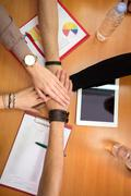 Hands together team unity concept - stock photo