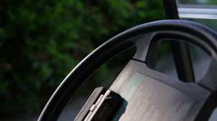 Black steering wheel in a golf car Stock Footage