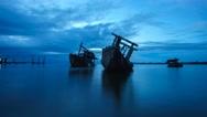 Stock Video Footage of Cloudy Sunrise Over Sabah River Sunken Boat Shipwrecks Timelapse