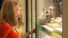 Smiling Women Chooses Jewelry At Store Stock Footage