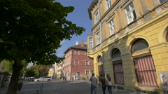Young people walking on a street in the city center of Sibiu Stock Footage