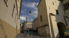 Walking and driving on the street in Sibiu Stock Footage