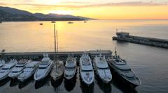 Aerial Monte Carlo sunrise Mediterranean Pier luxury yacht - stock footage