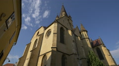 Street view of the Lutheran Cathedral of Saint Mary, Sibiu Stock Footage