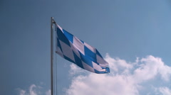 Bavarian flag in front of a blue sky Stock Footage