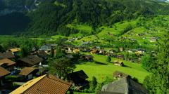 Switzerland Eiger mountain building valley tourism travel Stock Footage
