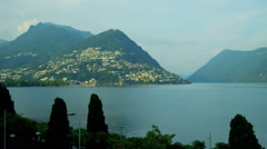 Lake Lugano Switzerland Alps Ticino Canton Italy walking Stock Footage