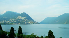 Lake Lugano Switzerland Alps forest mountain lake travel Stock Footage