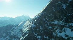 Aerial Eiger Switzerland Rock North Face snow ice valley Stock Footage