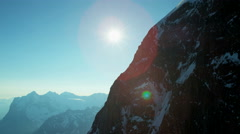 Aerial Eiger Switzerland valley mountain Alps sunlight travel Stock Footage